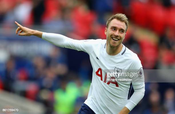 Christian Eriksen of Tottenham Hotspur celebrates scoring his sides first goal during the Premier League match between Tottenham Hotspur and AFC...