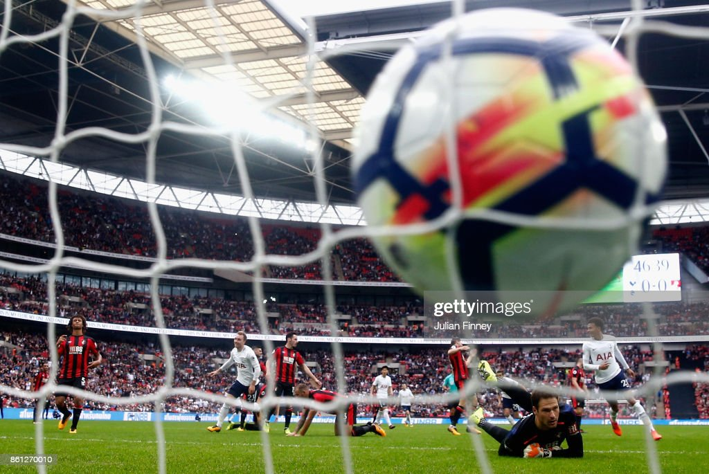 Christian Eriksen of Tottenham Hotspur celebrates scoring his sides first goal as Asmir Begovic of AFC Bournemouth reacts during the Premier League match between Tottenham Hotspur and AFC Bournemouth at Wembley Stadium on October 14, 2017 in London, England.