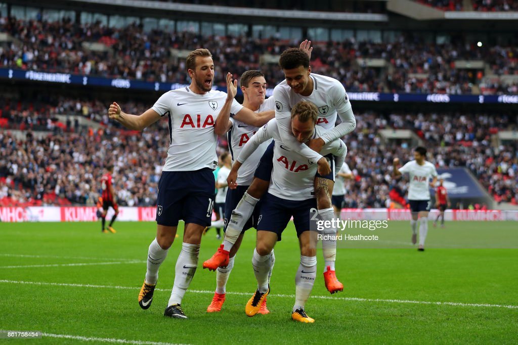 Christian Eriksen of Tottenham Hotspur celebrates scoring his sides first goal during the Premier League match between Tottenham Hotspur and AFC Bournemouth at Wembley Stadium on October 14, 2017 in London, England.