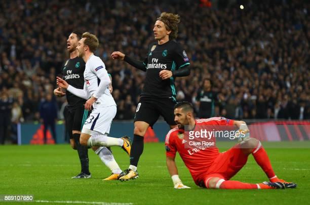 Christian Eriksen of Tottenham Hotspur celebrates scoring his side's third goal during the UEFA Champions League group H match between Tottenham...