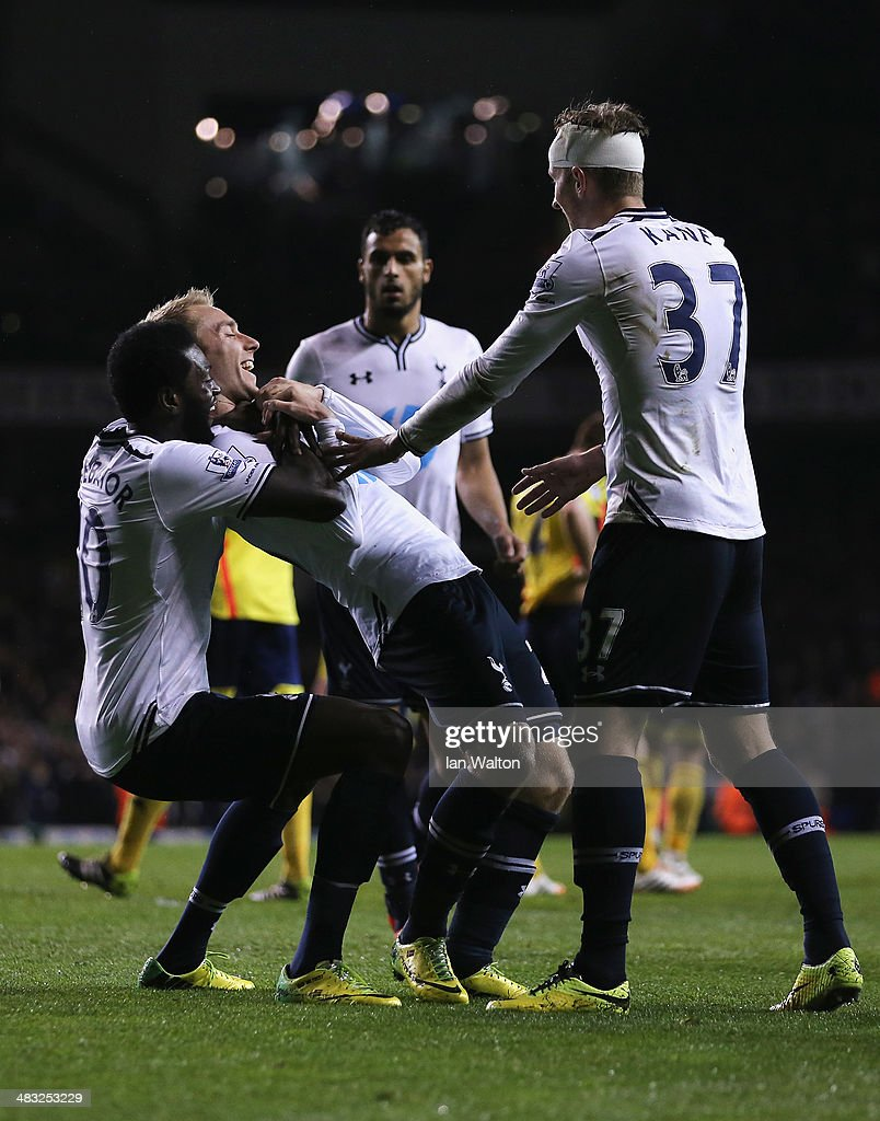 Christian Eriksen of Tottenham Hotspur celebrates scoring his team's third goal with Emmanuel Adebayor (L) of Tottenham Hotspur during the Barclays Premier League match between Tottenham Hotspur and Sunderland at White Hart Lane on April 7, 2014 in London, England.