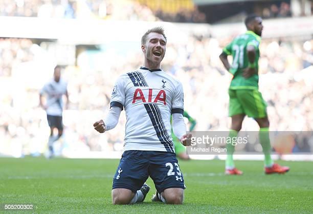 Christian Eriksen of Tottenham Hotspur celebrates scoring his team's first goal during the Barclays Premier League match between Tottenham Hotspur...