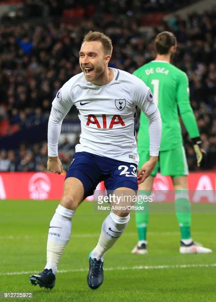 Christian Eriksen of Tottenham Hotspur celebrates scoring the opening goal during the Premier League match between Tottenham Hotspur and Manchester...