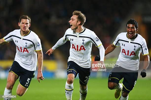 Christian Eriksen of Tottenham Hotspur celebrates scoring the winning goal with Jan Vertonghen and Paulinho during the Barclays Premier League match...