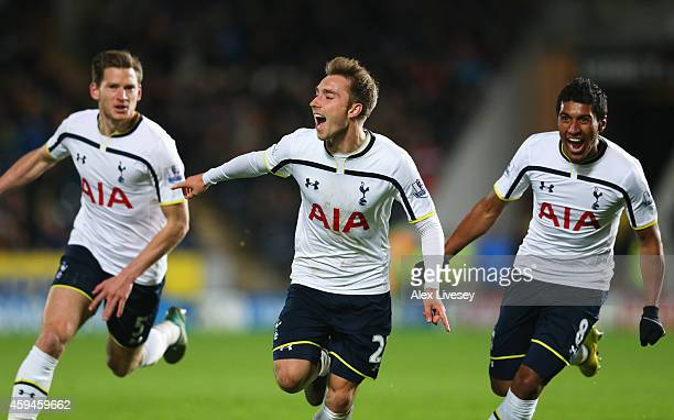 Christian Eriksen of Tottenham Hotspur celebrates scoring the winning goal with Jan Vertonghen and Paulinho during the Barclays Premier League match...