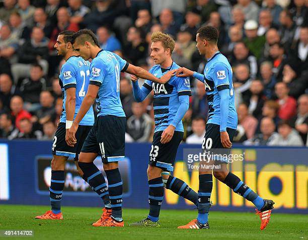 Christian Eriksen of Tottenham Hotspur celebrates scoring their first goal during the Barclays Premier League match between Swansea City and...