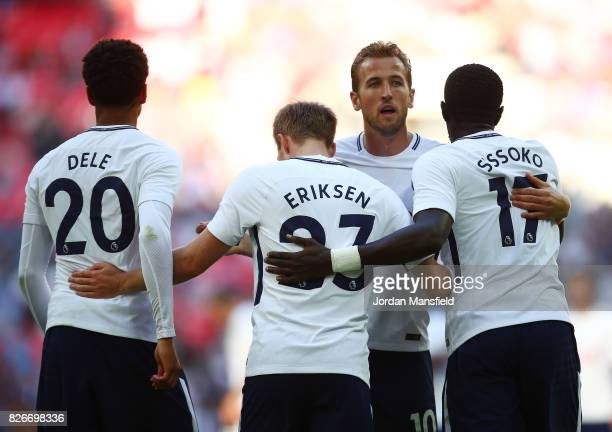 'LONDON ENGLAND AUGUST 05 Christian Eriksen of Tottenham Hotspur celebrates with Harry Kane Dele Alli and Moussa Sissoko after scoring his sides...