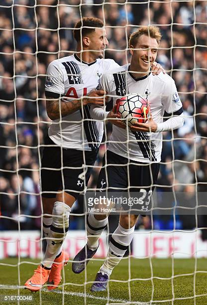 Christian Eriksen of Tottenham Hotspur celebrates with team mate Kyle Walker as he scores their third goal during the Barclays Premier League match...