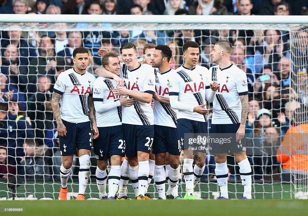Christian Eriksen of Tottenham Hotspur (23) celebrates with team mates as he scores their third goal during the Barclays Premier League match between Tottenham Hotspur and A.F.C. Bournemouth at White Hart Lane on March 20, 2016 in London, United Kingdom.