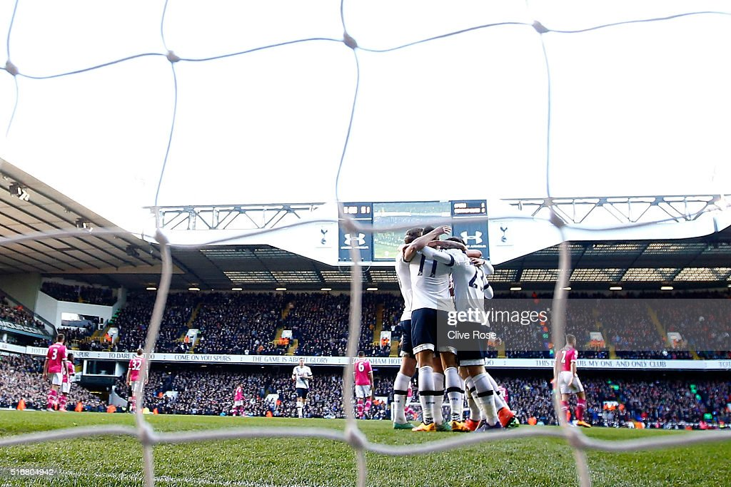 Christian Eriksen of Tottenham Hotspur (obscured) celebrates with team mates as he scores their third goal during the Barclays Premier League match between Tottenham Hotspur and A.F.C. Bournemouth at White Hart Lane on March 20, 2016 in London, United Kingdom.