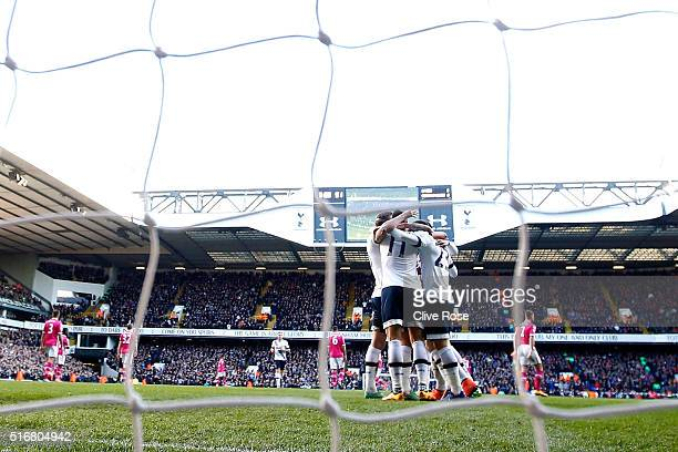 Christian Eriksen of Tottenham Hotspur celebrates with team mates as he scores their third goal during the Barclays Premier League match between...