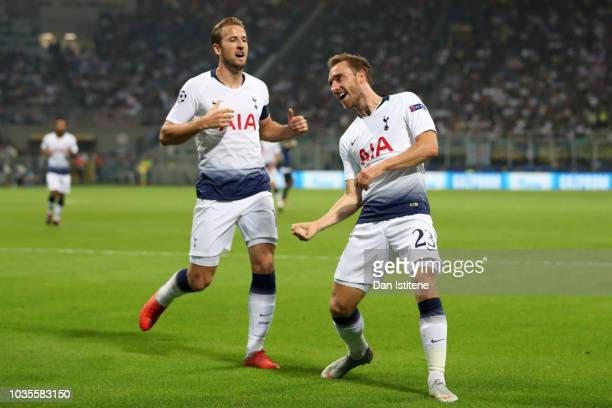 Christian Eriksen of Tottenham Hotspur celebrates with teammate Harry Kane after scoring his team's first goal during the Group B match of the UEFA...