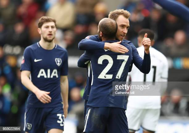 Christian Eriksen of Tottenham Hotspur celebrates with teammate Lucas Moura after scoring his sides third goal during The Emirates FA Cup Quarter...