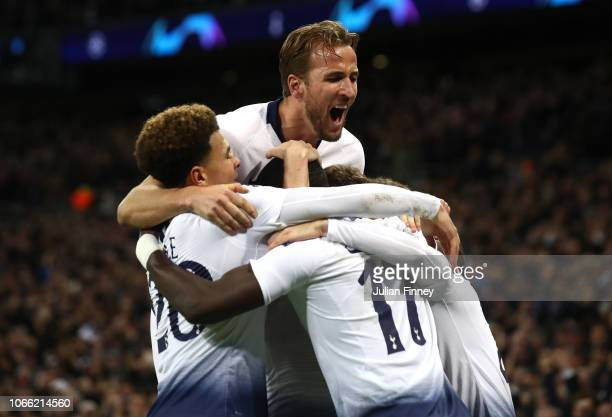 Christian Eriksen of Tottenham Hotspur celebrates with teammates after scoring his team's first goal during the UEFA Champions League Group B match...