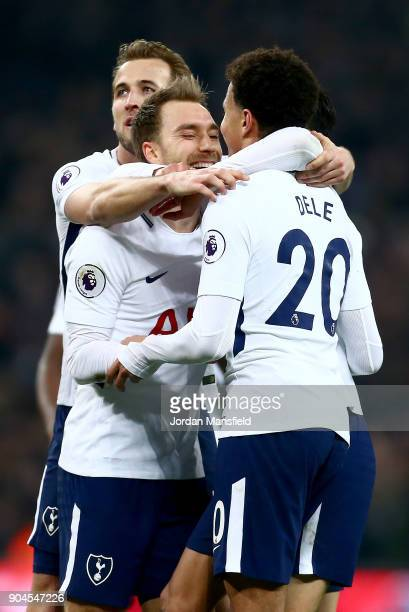 Christian Eriksen of Tottenham Hotspur celebrates with teammates after scoring his sides fourth goal during the Premier League match between...