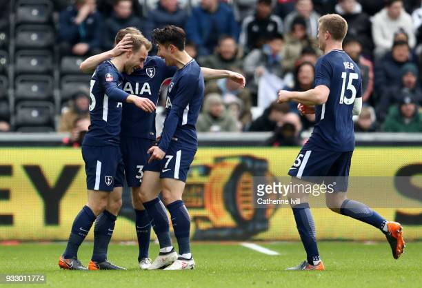 Christian Eriksen of Tottenham Hotspur celebrates with teammates after scoring his sides first goal during The Emirates FA Cup Quarter Final match...