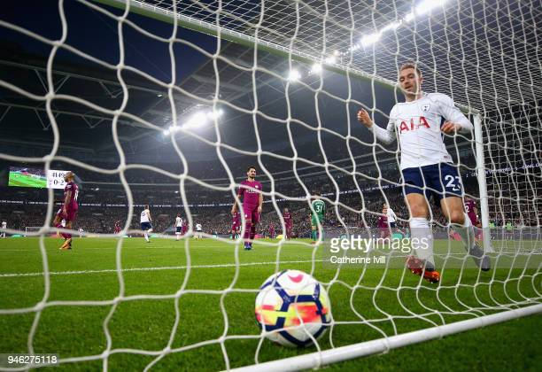 Christian Eriksen of Tottenham Hotspur collects the ball from the net after scoring his sides first goal during the Premier League match between...