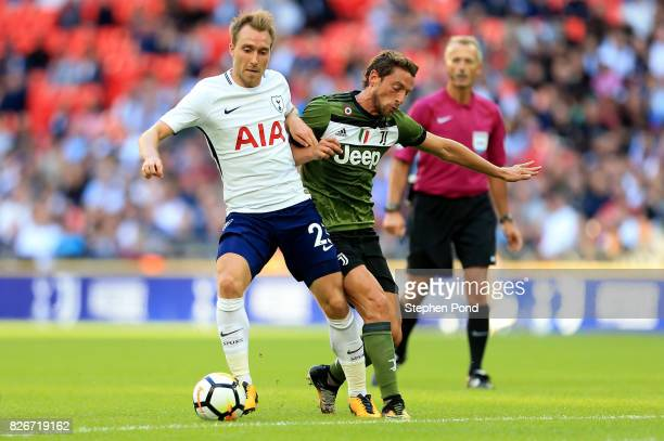 Christian Eriksen of Tottenham Hotspur competes with Claudio Marchisio of Juventus during the PreSeason Friendly match between Tottenham Hotspur and...