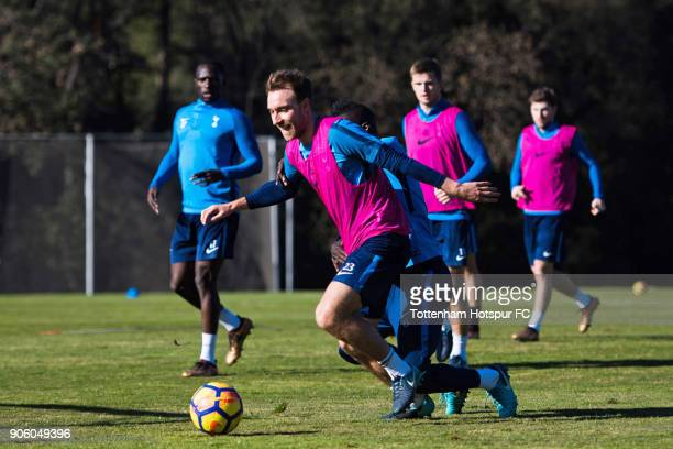 Christian Eriksen of Tottenham Hotspur conducts the ball under pressure from Davinson Sanchez during a training session during day three of the...