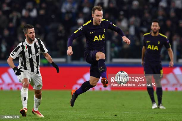 Christian Eriksen of Tottenham Hotspur controls the ball during the UEFA Champions League Round of 16 First Leg match between Juventus and Tottenham...
