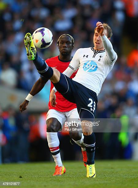 Christian Eriksen of Tottenham Hotspur controls the ball under the watchful eye of Bacary Sagna of Arsenal during the Barclays Premier League match...