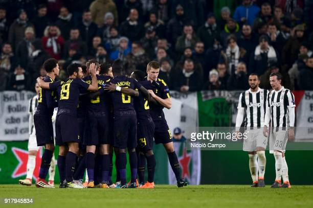 Christian Eriksen of Tottenham Hotspur FC celebrates with his teammates after scoring a goal during the UEFA Champions League Round of 16 First Leg...