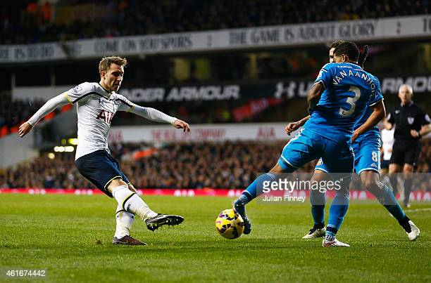 Christian Eriksen of Tottenham Hotspur has a shot blocked by Patrick van Aanholt of Sunderland during the Barclays Premier League match between...