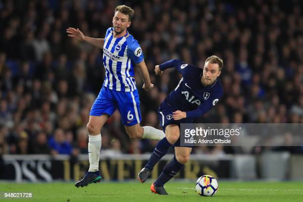 Christian Eriksen of Tottenham Hotspur in action with Dale Stephens of Brighton and Hove Albion during the Premier League match between Brighton and...
