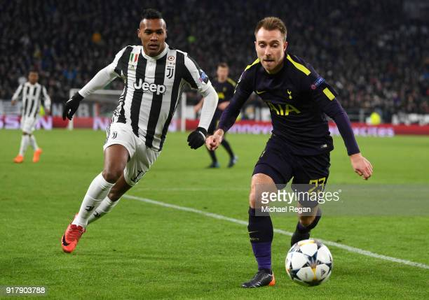 Christian Eriksen of Tottenham Hotspur is challenged by Alex Sandro of Juventus during the UEFA Champions League Round of 16 First Leg match between...