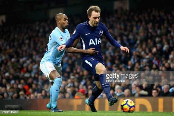 Christian Eriksen of Tottenham Hotspur is challenged by Fernandinho of Manchester City during the Premier League match between Manchester City and...