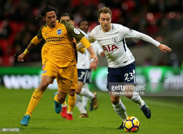 Christian Eriksen of Tottenham Hotspur is challenged by Matias Ezequiel Schelotto of Brighton and Hove Albion during the Premier League match between...