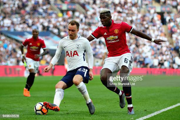 Christian Eriksen of Tottenham Hotspur is challenged by Paul Pogba of Manchester United during The Emirates FA Cup Semi Final match between...