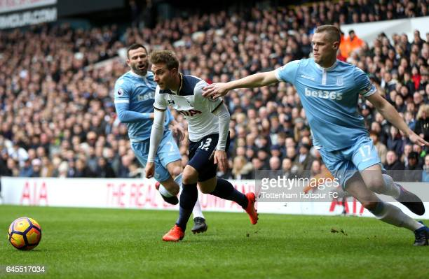 Christian Eriksen of Tottenham Hotspur is challenged by Ryan Shawcross of Stoke City during the Premier League match between Tottenham Hotspur and...