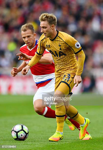 Christian Eriksen of Tottenham Hotspur is chased by Jordan Rhodes of Middlesbrough during the Premier League match between Middlesbrough and...