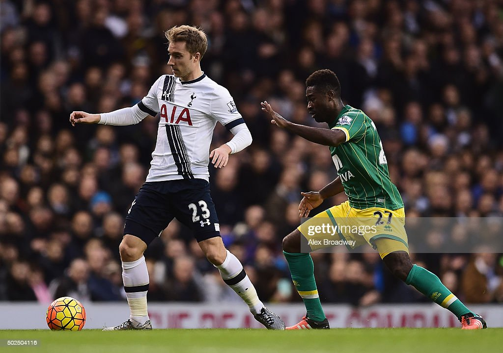 Christian Eriksen of Tottenham Hotspur is closed down by Alexander Tettey of Norwich City during the Barclays Premier League match between Tottenham Hotspur and Norwich City at White Hart Lane on December 26, 2015 in London, England.