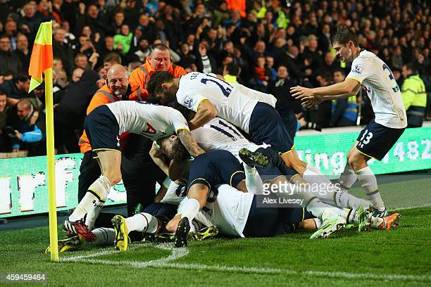 Christian Eriksen of Tottenham Hotspur is mobbed by team mates after scoring the winning goal during the Barclays Premier League match between Hull...