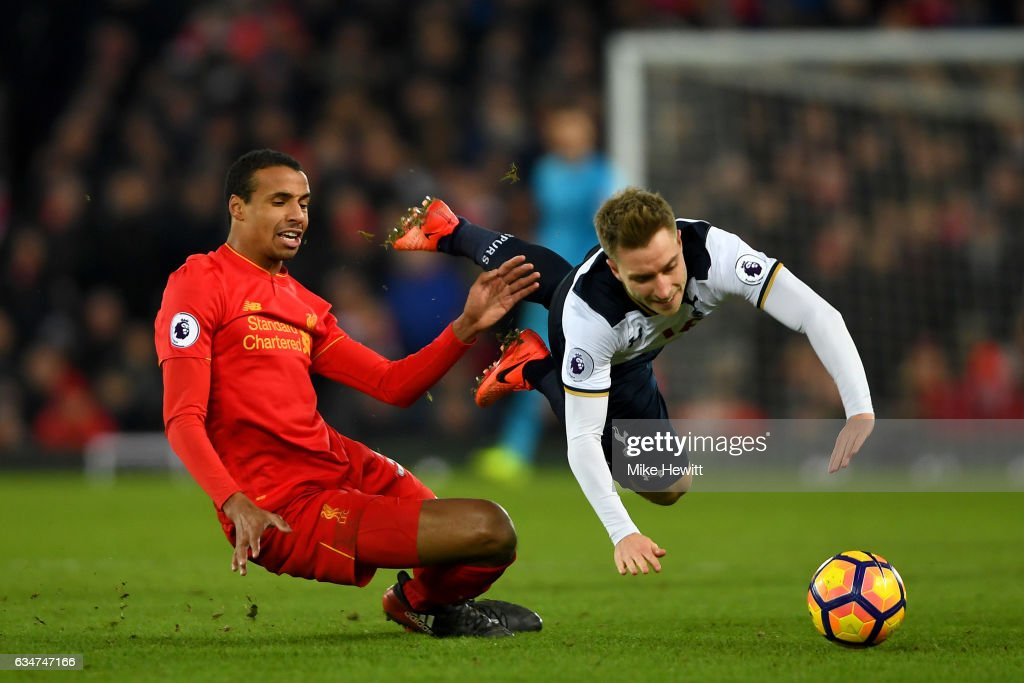 Christian Eriksen of Tottenham Hotspur is tackled by Georginio Wijnaldum of Liverpool during the Premier League match between Liverpool and Tottenham Hotspur at Anfield on February 11, 2017 in Liverpool, England.