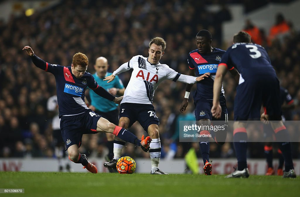 Christian Eriksen of Tottenham Hotspur is tackled by Jack Colback of Newcastle United during the Barclays Premier League match between Tottenham Hotspur and Newcastle United at White Hart Lane on December 13, 2015 in London, England.