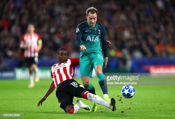 Christian Eriksen of Tottenham Hotspur is tackled by Pablo Rosario of PSV Eindhoven during the Group B match of the UEFA Champions League between PSV...