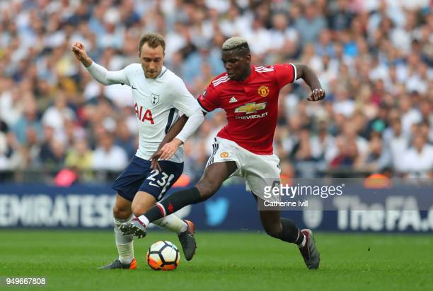 Christian Eriksen of Tottenham Hotspur is tackled by Paul Pogba of Manchester United during The Emirates FA Cup Semi Final between Manchester United...
