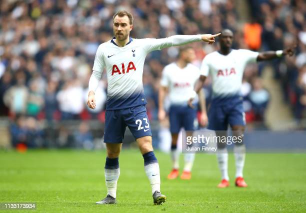 Christian Eriksen of Tottenham Hotspur looks on during the Premier League match between Tottenham Hotspur and Arsenal FC at Wembley Stadium on March...