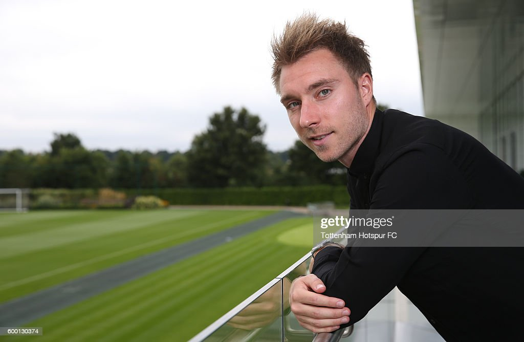 Christian Eriksen of Tottenham Hotspur poses after signing a new contract at the Tottenham Hotspur Training Ground on September 6, 2016 in Enfield, England.