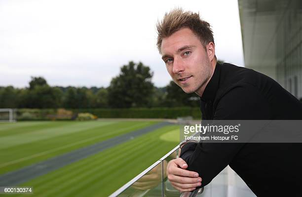 Christian Eriksen of Tottenham Hotspur poses after signing a new contract at the Tottenham Hotspur Training Ground on September 6 2016 in Enfield...
