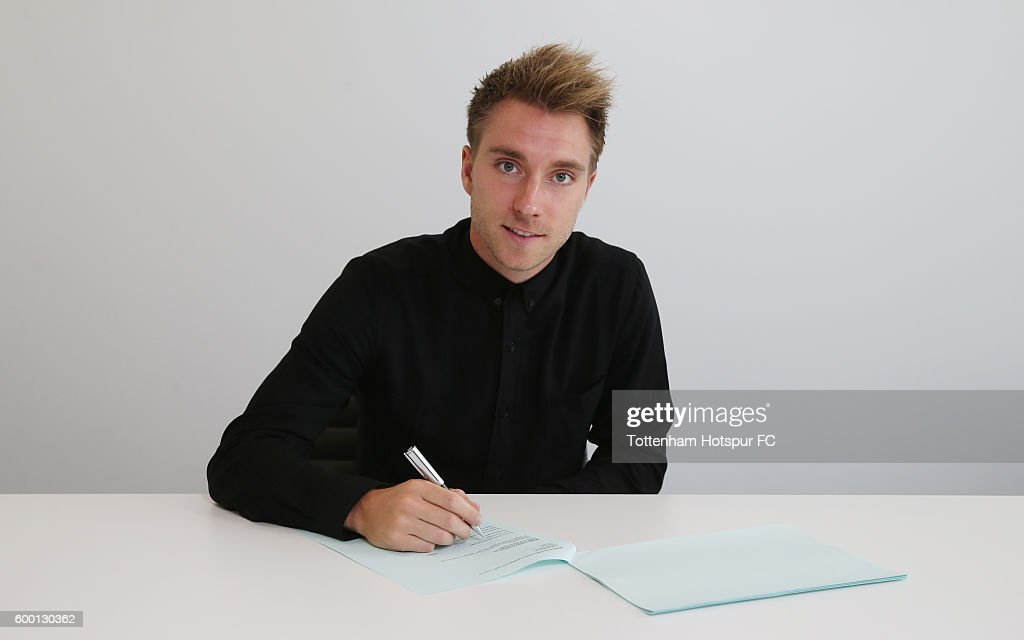 Christian Eriksen of Tottenham Hotspur poses while signing a new contract at the Tottenham Hotspur Training Ground on September 6, 2016 in Enfield, England.