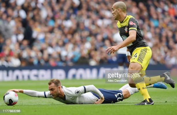 Christian Eriksen of Tottenham Hotspur reaches for the ball after a foul during the Premier League match between Tottenham Hotspur and Southampton FC...