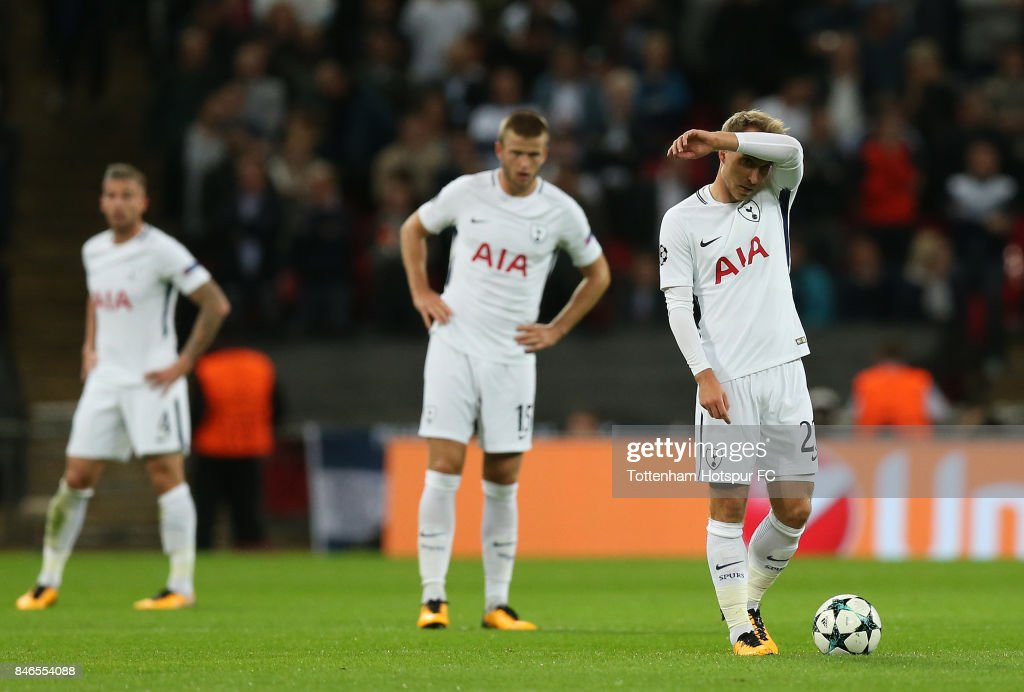 Christian Eriksen of Tottenham Hotspur reacts Borussia Dortmund first goal during the UEFA Champions League group H match between Tottenham Hotspur and Borussia Dortmund at Wembley Stadium on September 13, 2017 in London, United Kingdom.