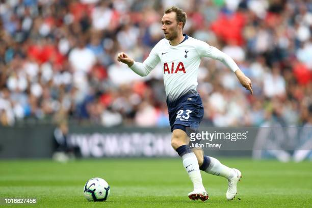 Christian Eriksen of Tottenham Hotspur runs with the ball during the Premier League match between Tottenham Hotspur and Fulham FC at Wembley Stadium...