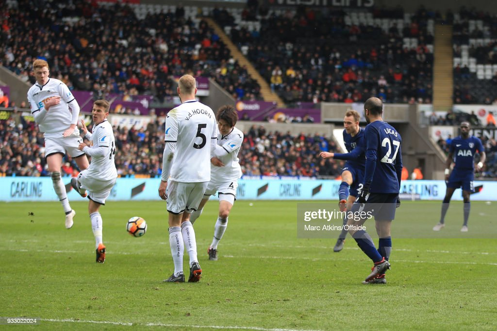 Christian Eriksen of Tottenham Hotspur scores his 2nd goal during the Emirates FA Cup Quarter Final match between Swansea City and Tottenham Hotspur at Liberty Stadium on March 17, 2018 in Swansea, Wales.