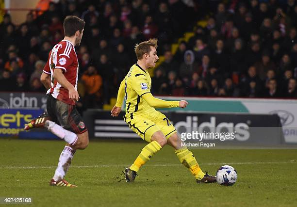 Christian Eriksen of Tottenham Hotspur scores his second goal during the Capital One Cup SemiFinal Second Leg match between Sheffield United and...