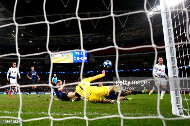 Christian Eriksen of Tottenham Hotspur scores his sides first goal during the UEFA Champions League Group B match between Tottenham Hotspur and FC...